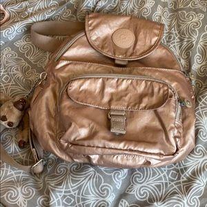 Kipling rose gold medium backpack